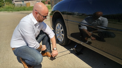 how to change a tire on a car - the sharp gentleman